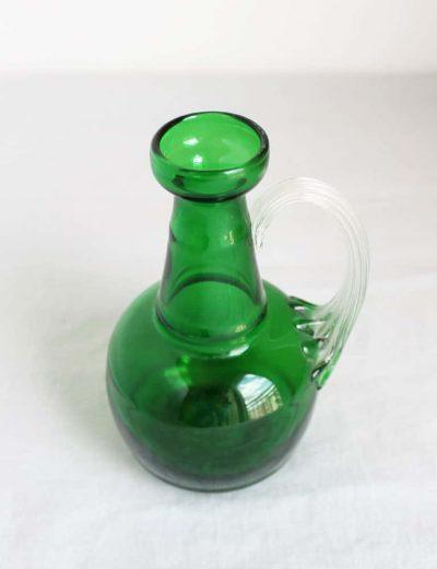 Žalia stiklinė vazelė